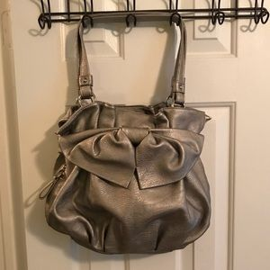 Like new! Silver bow purse